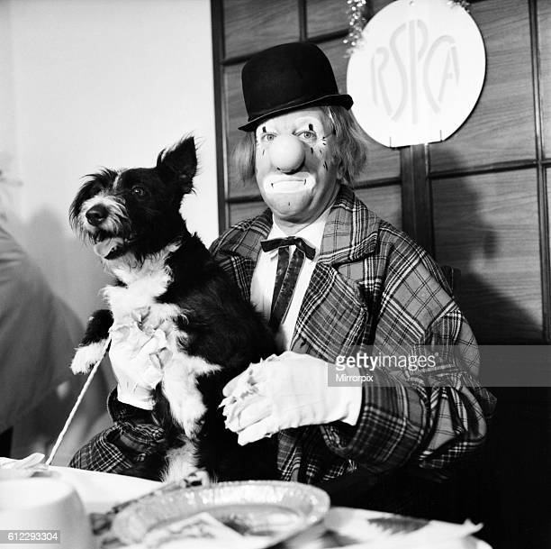 'Hobo' plays host to the doggy guests enjoying a menu of biscuits dogmeat turkey gravysauce and chocolatedrops December 1970 7011583007