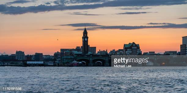 hoboken train terminal at sunset - hoboken stock pictures, royalty-free photos & images