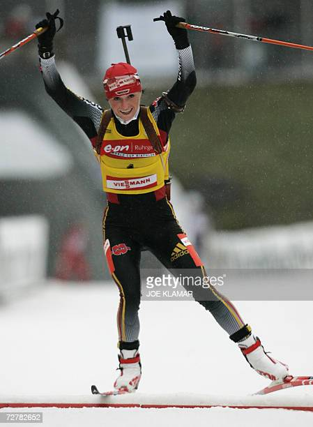 Andrea Henkel of Germany celebrates her victory while crossing the finish line in the women's 10 km pursuit during the IBU Biathlon World Cup in...