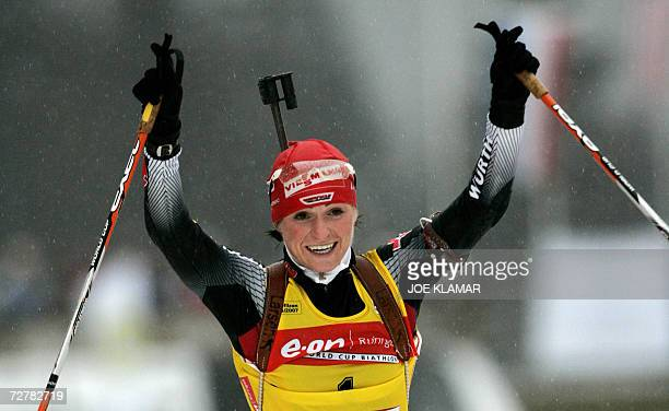 Andrea Henkel of Germany celebrates her victory while crosses the finish line in the women's 10 km pursuit during IBU Biathlon World Cup in...