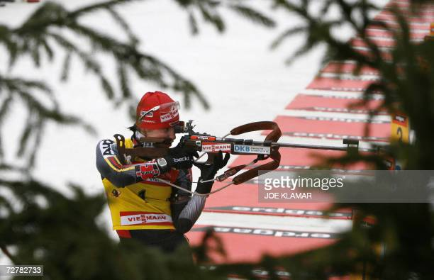 Andrea Henkel of Germany takes her third shooting in the women's 10 km pursuit during the IBU Biathlon World Cup in Hochfilzen 09 December 2006...