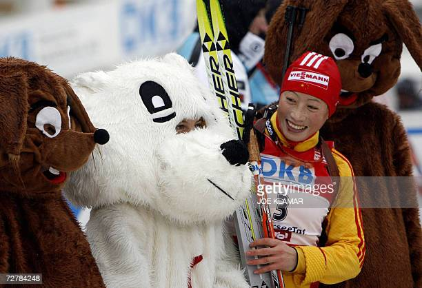 China's Yingchao Kong is surrounded by mascots in the finish of the women's 10 km pursuit during the IBU Biathlon World Cup in Hochfilzen 09 December...