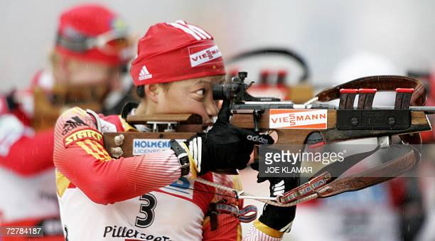 China's Yingchao Kong takes her shoot in the women's 10 km pursuit during the IBU Biathlon World Cup in Hochfilzen 09 December 2006 Germany's Andrea...