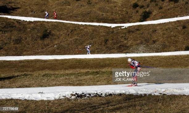 Competitors comete in the women's 7.5 km sprint during the IBU Biathlon World Cup in Hochfilzen 08 December 2006. Germany's Henkel won ahead of...