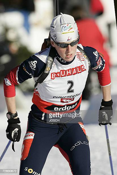 French Sandrine Bailly competes during the women's 75 km sprint at the Biathlon World Cup in Hochfilzen 15 December 2006 Sweden's Anna Carin Olofsson...