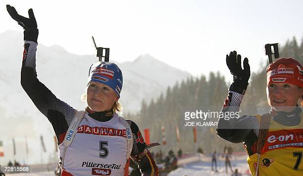 Germany's Andrea Henkel and Martina Glagow celebrate in the finish of the women's 15 km individual during the Biathlon World Cup in Hochfilzen 13...