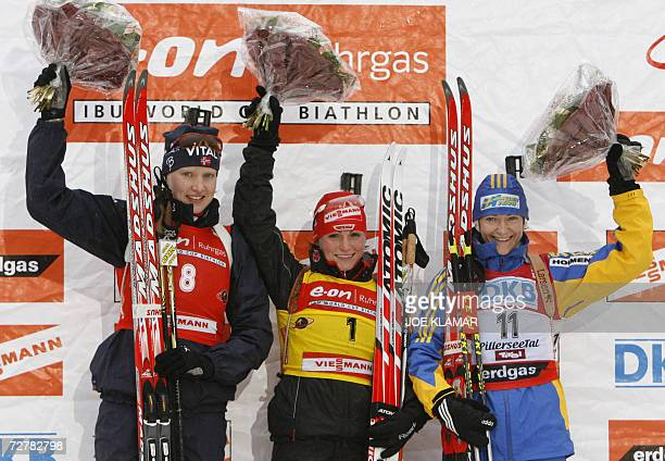 Germany's Andrea Henkel Norway's Linda Grubben and Sweden's Anna Carin Olofsson poses on the winner's podium in women's 10 km pursuit during the IBU...