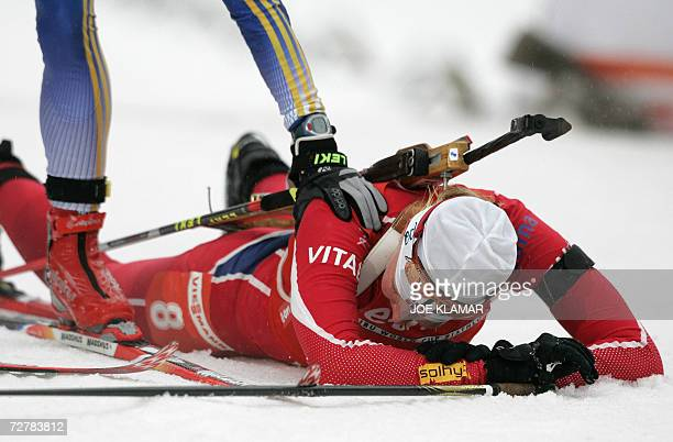 Linda Grubben of Norway is congratulated by Sweden's Anna Carin Olofsson after finishing the women's 10 km pursuit during the IBU Biathlon World Cup...
