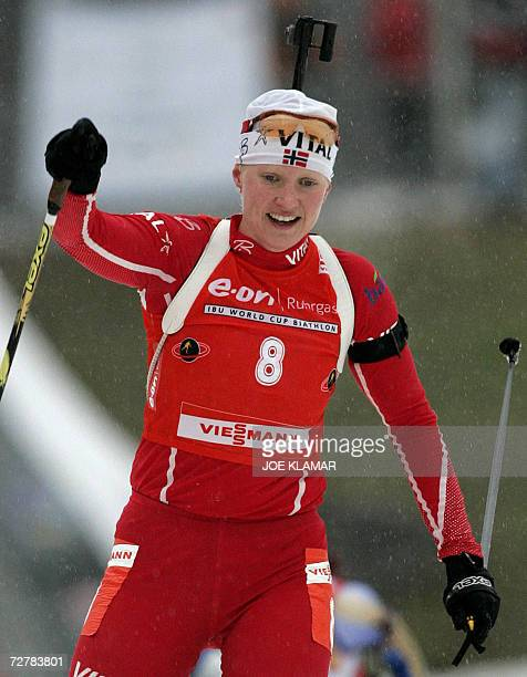 Norway's Linda Grubben celebrates her second place while finishing the women's 10 km pursuit during the IBU Biathlon World Cup in Hochfilzen 09...