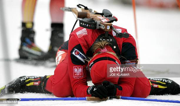 Poland's Crystina Palka reacts after finishing the women's 10 km pursuit during the IBU Biathlon World Cup in Hochfilzen 09 December 2006 Germany's...