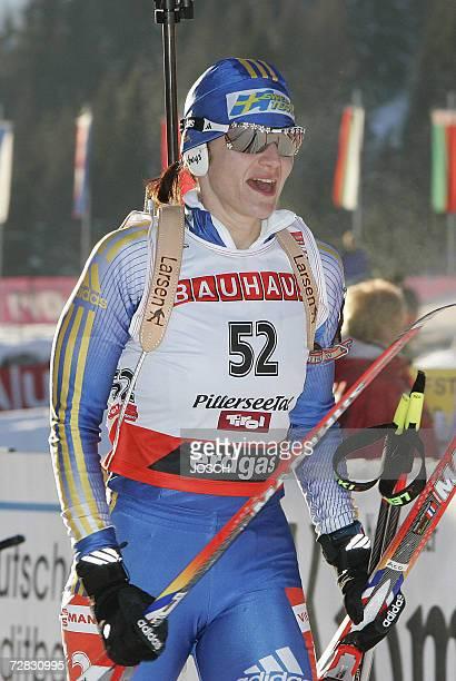 Sweden's Anna Carin Olofsson celebrates after winning the women's 75 km sprint at the Biathlon World Cup in Hochfilzen 15 December 2006 Sweden's Anna...