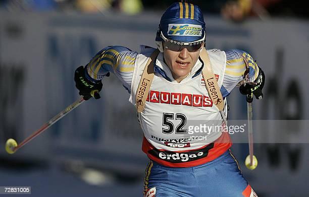 Sweden's Anna Carin Olofsson competes winning the women's 75 km sprint at the Biathlon World Cup in Hochfilzen 15 December 2006 Sweden's Anna Carin...