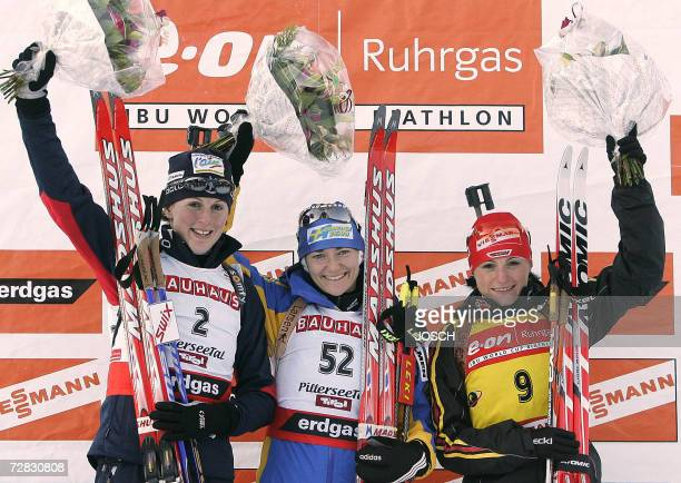Sweden's Anna Carin Olofsson French Sandrine Bailly and German Andrea Henkel pose on the podium after the women's 75 km sprint at the Biathlon World...
