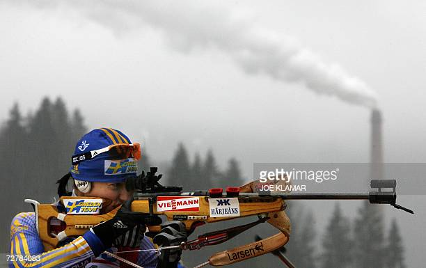 Sweden's Anna Carin Olofsson takes her shoot in the women's 10 km pursuit during the IBU Biathlon World Cup in Hochfilzen 09 December 2006 Germany's...