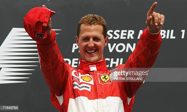 German Ferrari driver Michael Schumacher celebrates on the podium of the Hockenheim racetrack after the German Grand Prix, 30 July 2006, in...