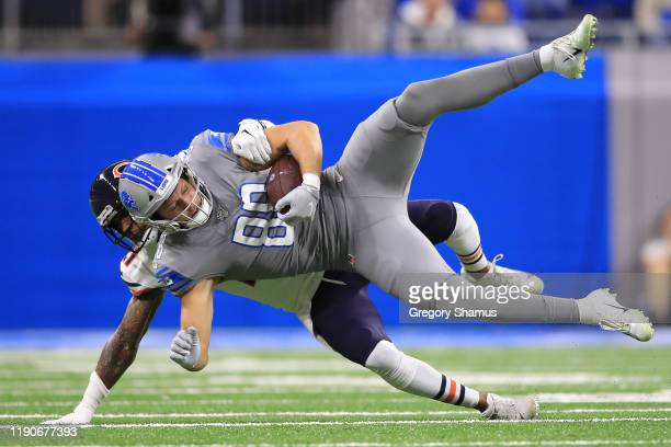 Hockenson of the Detroit Lions battles for yards after a first half catch against Ha Ha Clinton-Dix of the Chicago Bears at Ford Field on November...