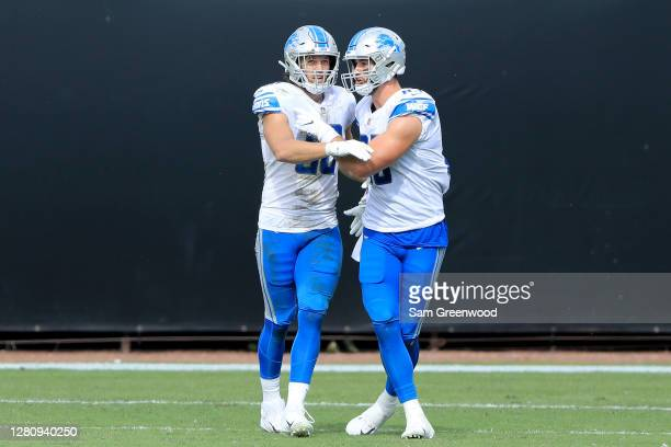 Hockenson of the Detroit Lions celebrates with his teammate Jesse James after scoring a touchdown against the Jacksonville Jaguars during the third...