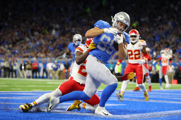 J Hockenson of the Detroit Lions scores a touchdown against Bashaud Breeland of the Kansas City Chiefs in the first quarter of the game at Ford Field...