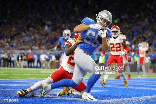Hockenson of the Detroit Lions scores a touchdown against Bashaud Breeland of the Kansas City Chiefs in the first quarter of the game at Ford Field...
