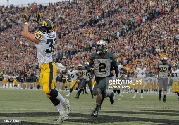 J Hockenson of the Iowa Hawkeyes catches a touchdown pass in the end zone as Kenneth Major of the Purdue Boilermakers defends at RossAde Stadium on...
