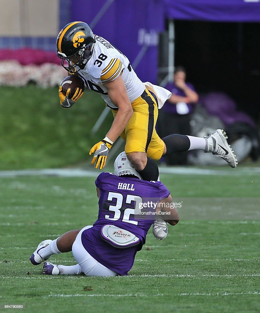 T.J. Hockenson #38 of the Iowa Hawkeyes is tackled by Nate Hall #32 of the Northwestern Wildcats at Ryan Field on October 21, 2017 in Evanston, Illinois.
