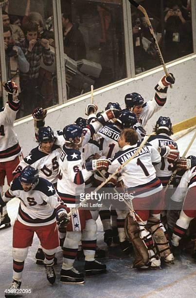 1980 Winter Olympics Team USA goalie Steve Janaszak Steve Christoff Mark Wells Bill Baker and teammates victorious after winning Medal Round game vs...