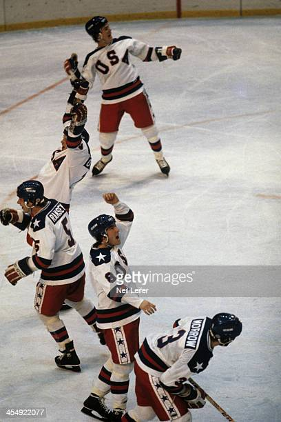 1980 Winter Olympics Team USA Jack O'Callahan Mike Ramsey Dave Silk and teammates victorious after winning Medal Round game vs USSR at Olympic...