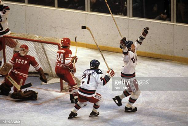 1980 Winter Olympics Team USA Mike Eruzione victorious with Bill Baker after scoring goal to take 43 lead in third period vs USSR at Olympic...