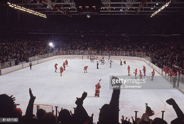 Hockey 1980 Winter Olympics Team USA victorious after winning game vs USSR View of Olympic Center stadium Lake Placid NY 2/22/1980