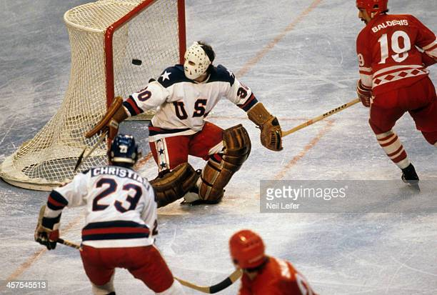 1980 Winter Olympics USA goalie Jim Craig in action vs USSR Helmuts Balderis during Medal Round at Olympic Fieldhouse in the Olympic Center Miracle...