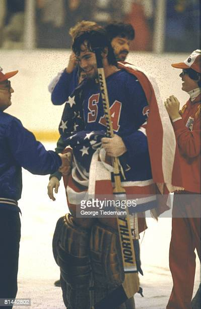 Hockey 1980 Winter Olympics USA goalie Jim Craig victorious with flag after winning gold medal game vs FIN Lake Placid NY 2/24/1980