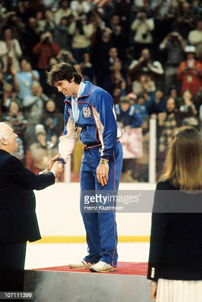 1980 Winter Olympics USA hockey team goalie Jim Craig victorious receiving gold medal on stand at the Olympic Center Lake Placid NY 2/24/1980 Credit...