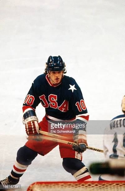 1980 Winter Olympics USA Mark Johnson in action vs Finland goalie Jorma Valtonen during Gold Medal game at Olympic Fieldhouse in the Olympic Center...