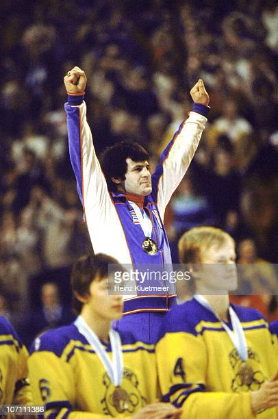 1980 Winter Olympics USA Men's Ice Hockey captain Mike Eruzione on stand victorious after receiving gold medal at Olympic Center Lake Placid NY...