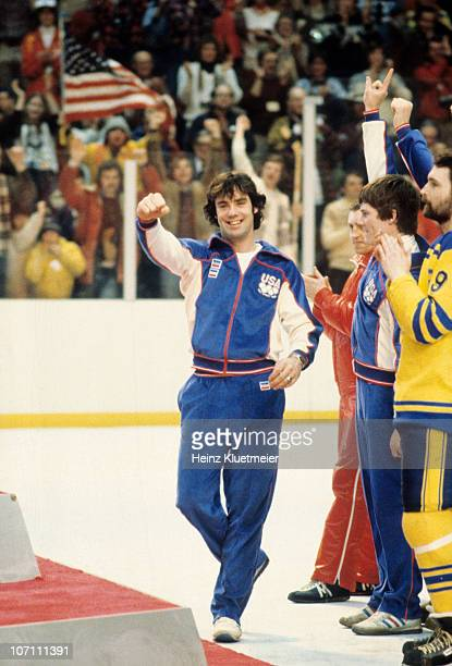 1980 Winter Olympics USA Men's Ice Hockey goalie Jim Craig on stand victorious after receiving gold medal at Olympic Center Lake Placid NY 2/24/1980...