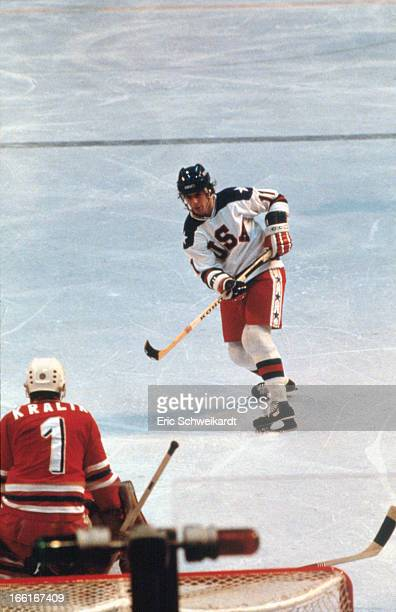 1980 Winter Olympics USA Steve Christoff in action vs Czechoslovakia goalie Jiri Kralik during Round 1 Blue Division game at Olympic Fieldhouse in...