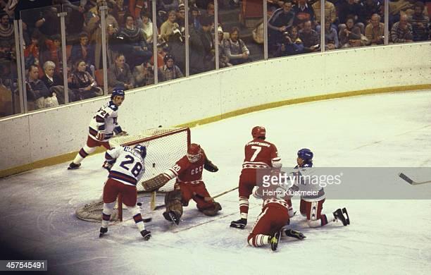 1980 Winter Olympics USSR goalie Vladislav Tretiak in action making save vs USA John Harrington during Medal Round game at Olympic Fieldhouse in the...