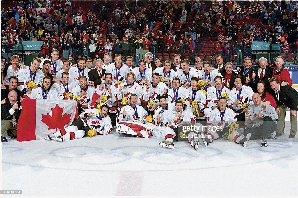 Winter Olympics, Portrait of Team Canada victorious with gold medal