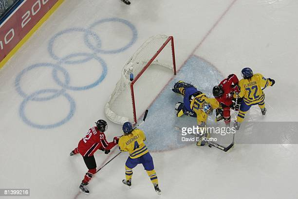 Hockey 2006 Winter Olympics Aerial view of Canada Colleen Sostorics in action vs Sweden goalie Kim Martin and Emma Eliasson during Women's Gold Medal...