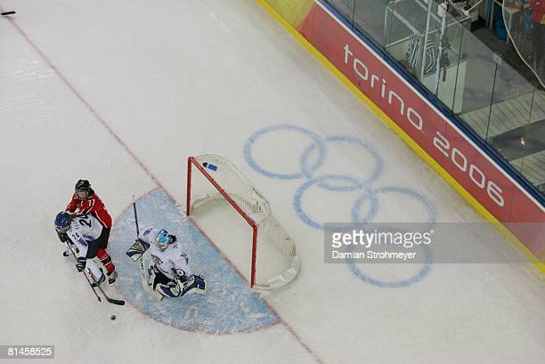 Hockey 2006 Winter Olympics Aerial view of Finland goalie Maija Hassinen and Kati Kovalainen in action yielding goal vs Canada Cassie Campbell during...