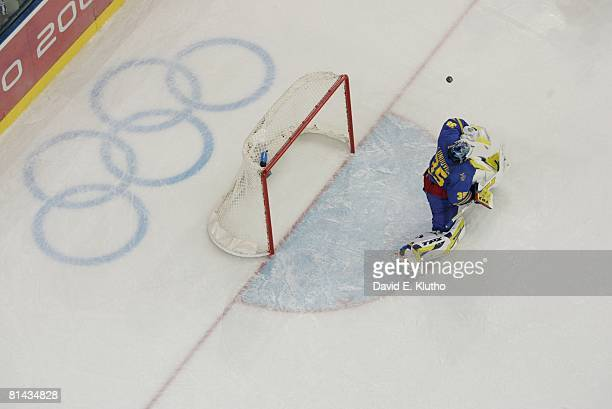 Hockey 2006 Winter Olympics Aerial view of Sweden goalie Henrik Lundqvist in action making save vs Finland during Gold Medal Game at Palasport...