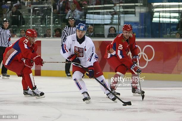 Hockey: 2006 Winter Olympics, Czech Republic David Vyborny in action vs Russia Alexei Yashin during Bronze Medal Game at Palasport Olimpico, Turin,...