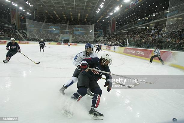 Hockey 2006 Winter Olympics USA Courtney Kennedy in action vs Finland Mari Pehkonen during Women's Preliminary Round Group B game at Palasport...