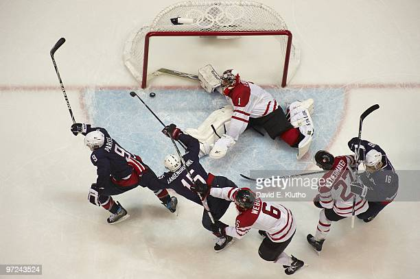 2010 Winter Olympics Aerial view of USA Zach Parise victorious celebration with Jamie Langenbrunner after scoring game tying goal with 244 seconds...