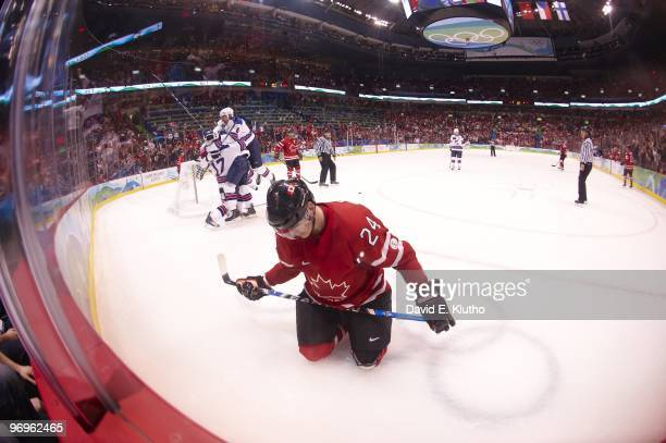 2010 Winter Olympics Canada Corey Perry upset while USA Ryan Kesler victorious celebrates empty net goal with teammate Erik Johnson during 3rd period...