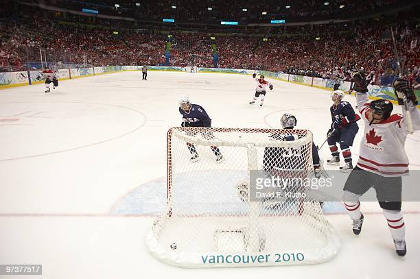 2010 Winter Olympics Canada Sidney Crosby victorious celebration after scoring game winning overtime goal vs USA goalie Ryan Miller during Men's Gold...