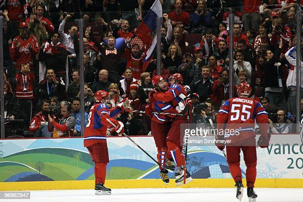 2010 Winter Olympics Russia Alex Ovechkin and Evgeni Malkin victorious during Men's Preliminary Round Group B Game 16 vs Czech Republic at Canada...