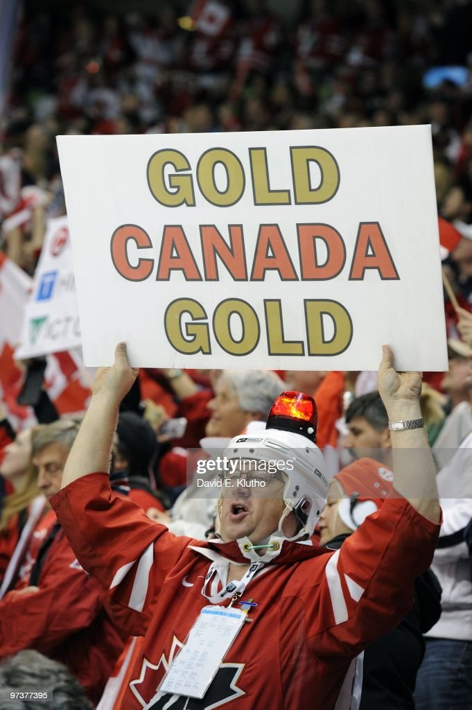 Team Canada fan in stands with GOLD CANADA GOLD sign during Women's Gold Medal Game - Game 20 vs USA at Canada Hockey Place. Vancouver, Canada 2/25/2010