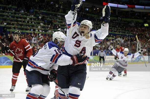 2010 Winter Olympics USA Brian Rafalski and Jamie Langenbrunner victorious after scoring goal during 3rd period of Men's Preliminary Round Group A...
