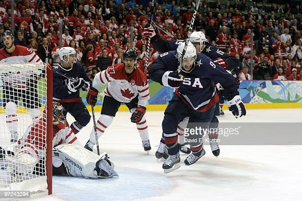 2010 Winter Olympics USA Zach Parise victorious celebration with Jamie Langenbrunner after scoring game tying goal with 244 seconds left in 3rd...